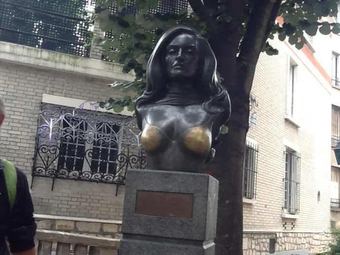 Dalida's bronzed boobs polished to a high sheen from all the palming.