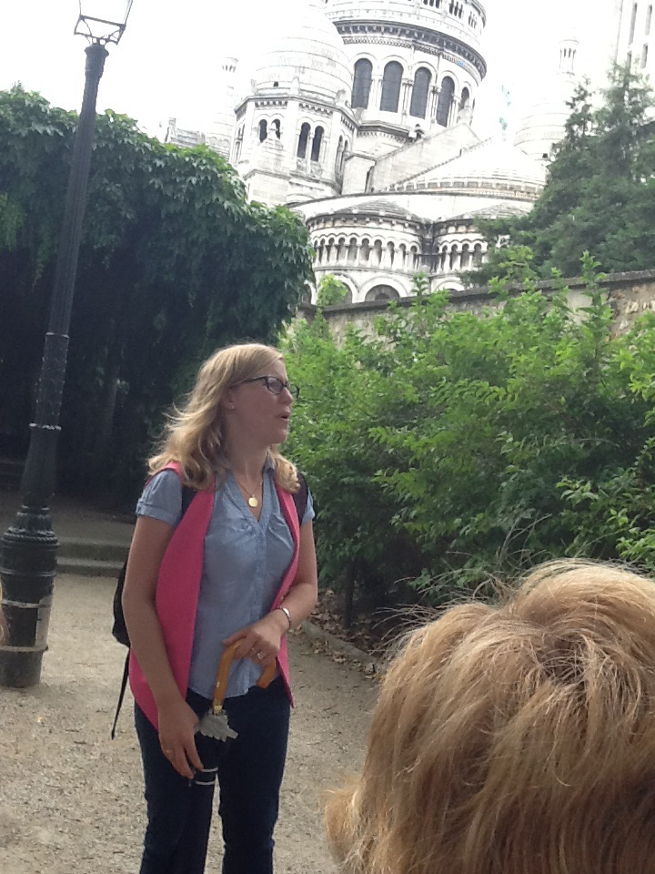 Our Montmartre guide, Marie, hard at work with the Sacre Coeur in the background.