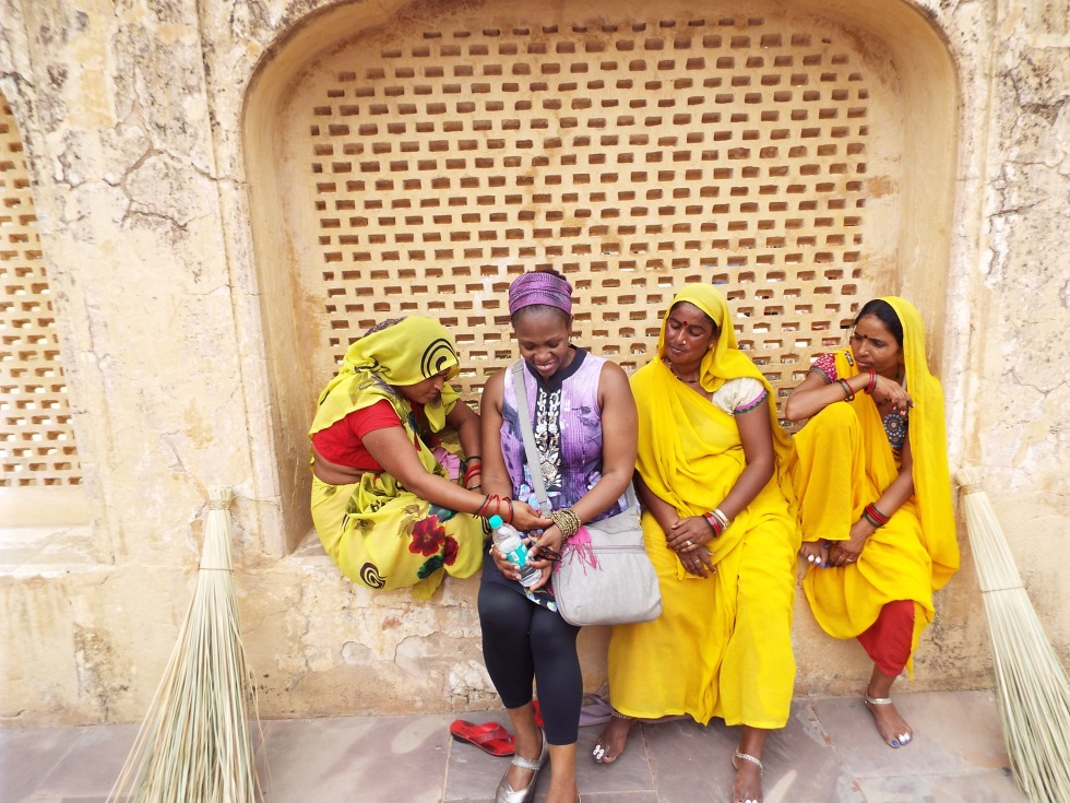 I thought these women looked like personified marigolds in their dazzling yellow saris.  They are actually pretty savvy sweepers at the Queen's palace, hiding in this alcove, and offering to pose for pictures for a few rupees.