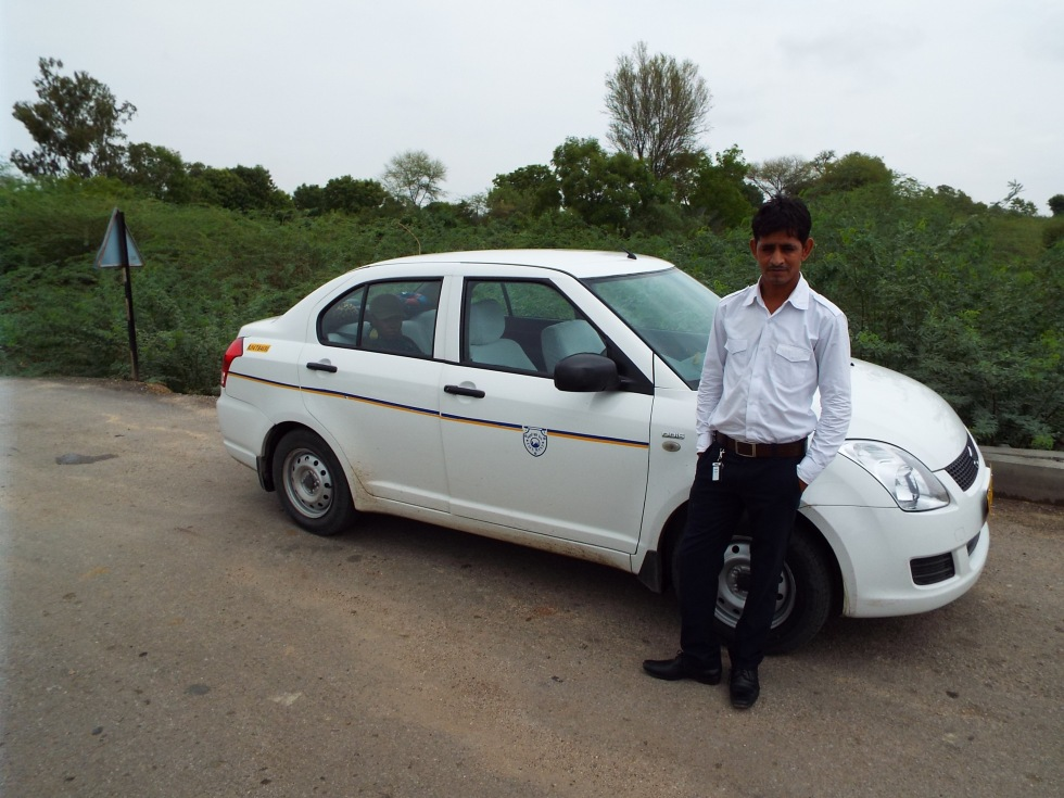 Ashok, our driver and constant companion with his immaculate car.