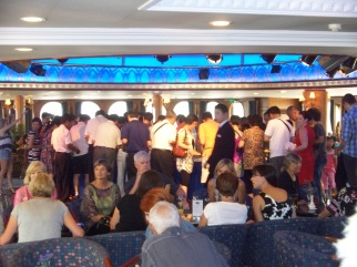Diners at the buffet, immediately following the captain's toast.