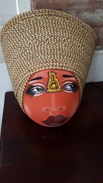 I've named this mask designed by Jacmel artist and activist Charlotte Charles, Miriam (for Miriam Makeba). She is my one retail indulgence so far. Her head is actually a large, dried out gourd. According to Charlotte, these masks are inspired to protest colorism in Haitian society, and to celebrate the beauty of all shades.