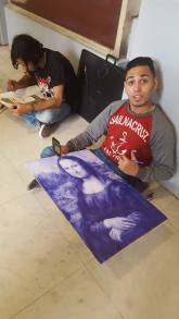 A young artist at the Egyptian Museum recreating the Mona Lisa in blue ball point pen
